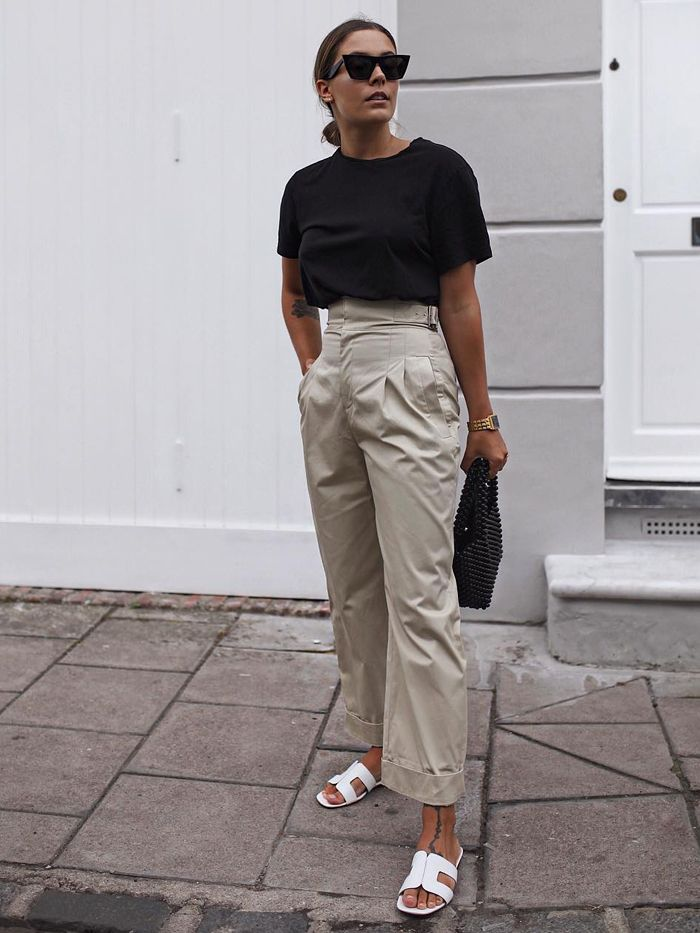 dune loupe sandals: hannah crosskey wearing dune sandals with beige trousers and a black t-shirt