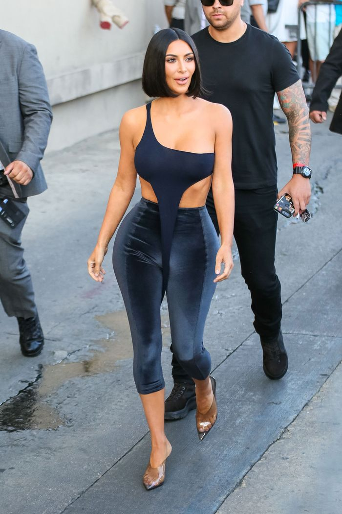 Kim Kardashian wearing black velvet leggings and crop top