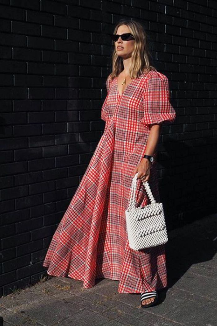 Trending summer dresses: Alexis Foreman wearing Ganni check dress