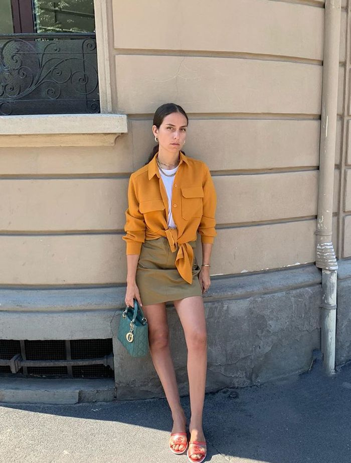 What To Wear In August: Erika Boldrin in a mini skirt and shirt