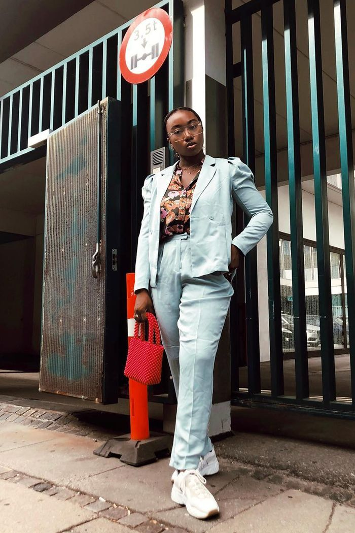 Copenhagen Fashion Week street style: Nnenna Echem wearing a blue suit and Acne trainers