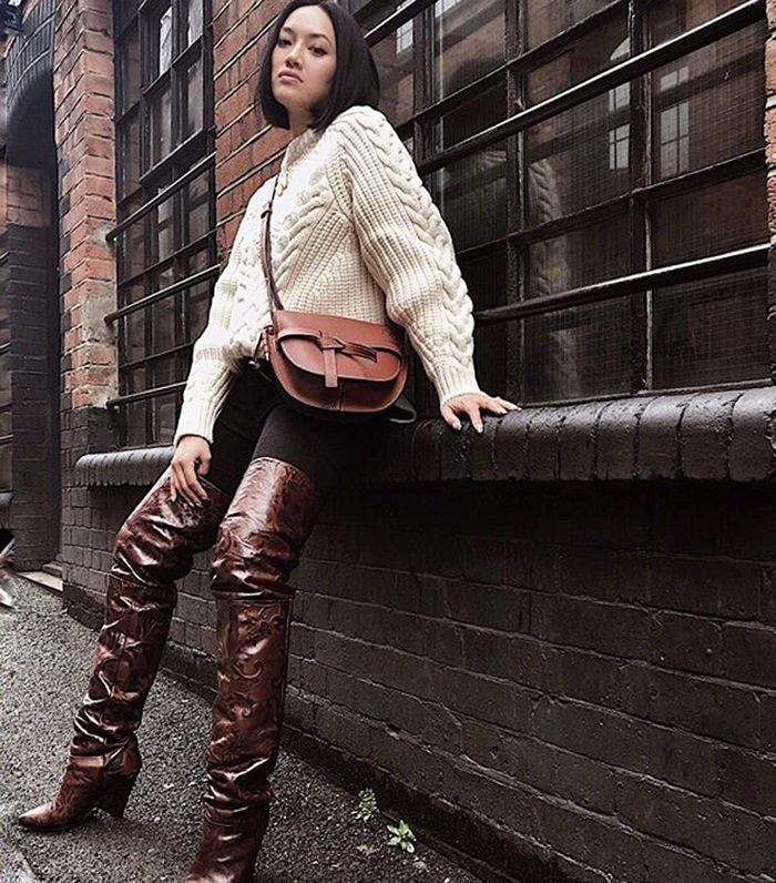 Best slouch boots: Tiffany Hsu wearing over-the-knee slouch boots
