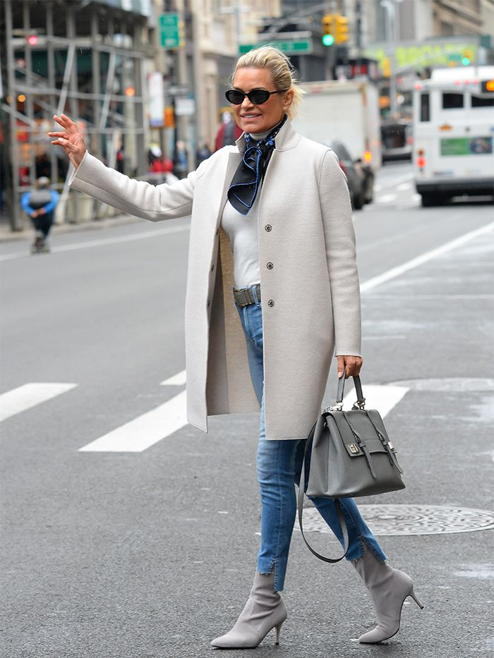 Yolanda Hadid style: Yolanda looks chic in a cream coat and grey suede boots