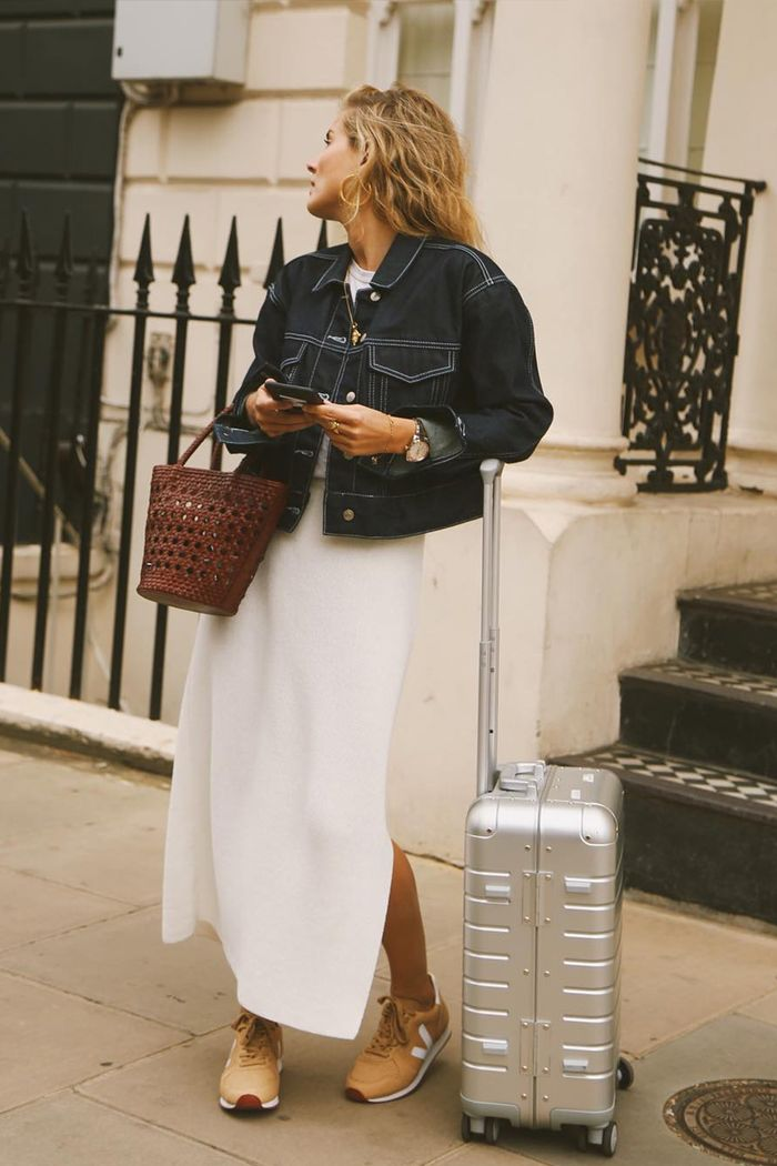 Carry on capsule wardrobe: Lucy Williams wearing denim jacket and knitted skirt
