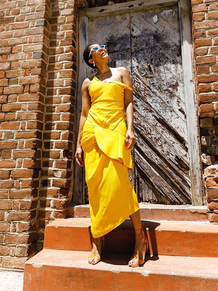 Italian Outfits: Tamu McPherson wearing a yellow strappy dress with lace-up heels