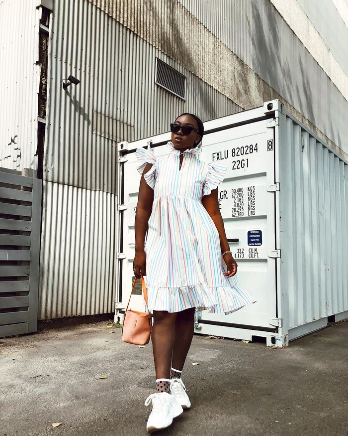 Dress and sneaker outfit with striped dress