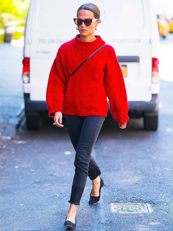 Alicia Vikander Style: Alicia Vikander wears a red jumper on a walk in Tribeca, NY