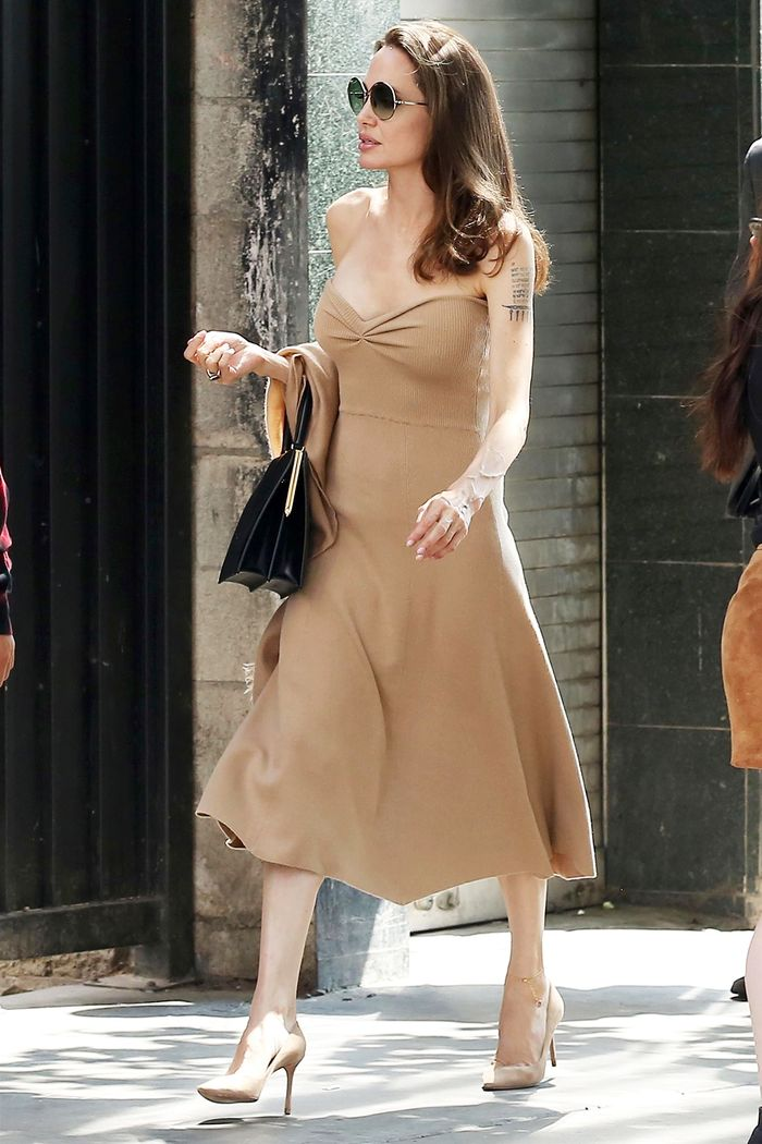 Angelina Jolie naked dress: worn with nude heels and black handbag
