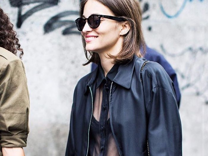All black outfits for fall: sheer blouse and leather jacket