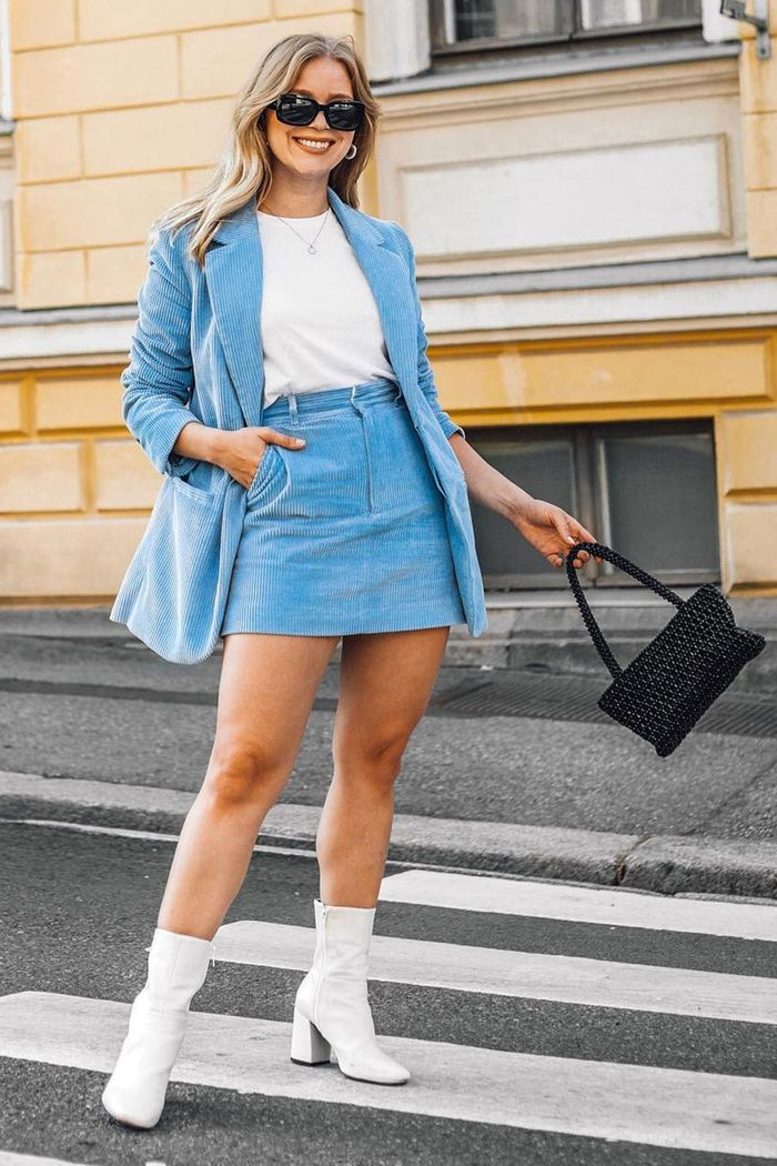 H&M corduroy suit: Milla Kuoksa wearing H&M suit with white boots