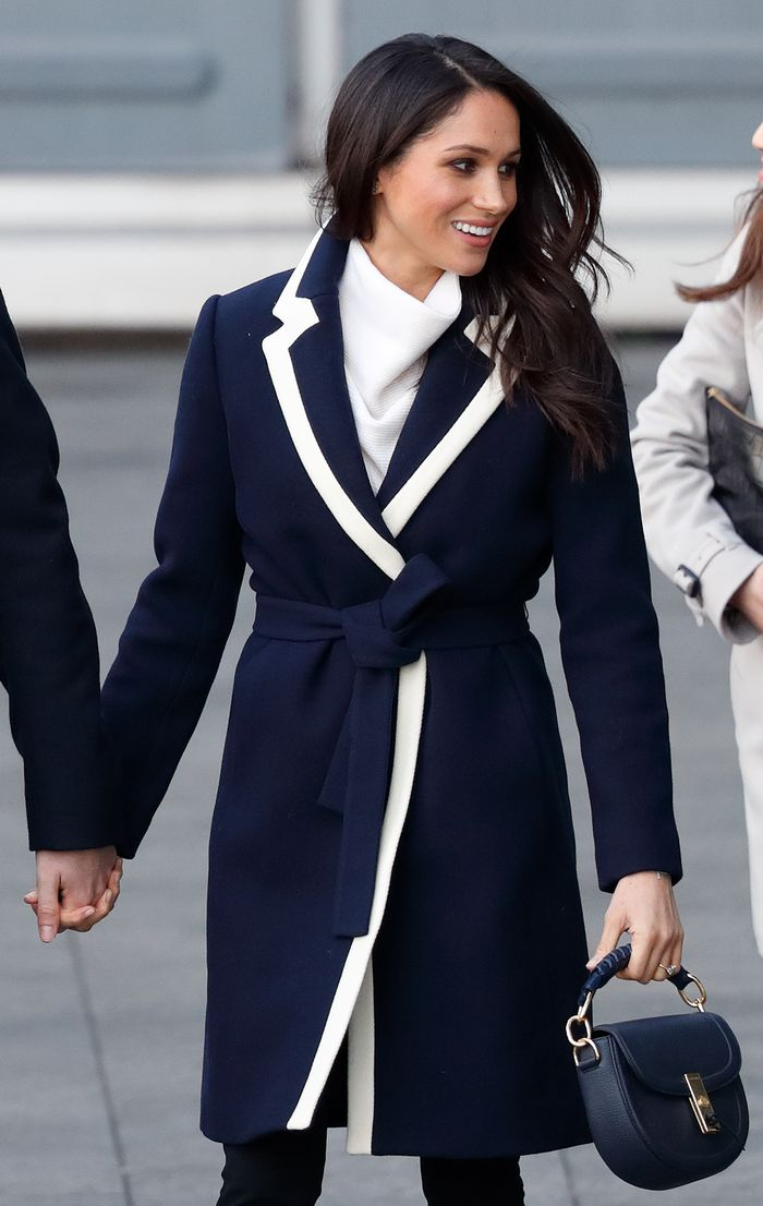 Meghan Markle wearing J.Crew's navy tipped wrap coat