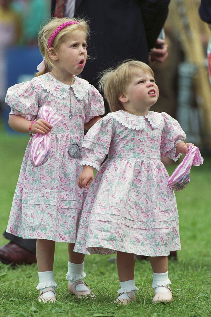 Young Princess Beatrice and Eugenie wearing floral dresses