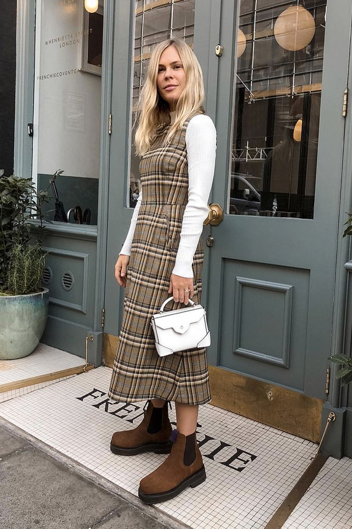 Layering dresses: Jessie Bush wearing a checked shift with a white roll-neck