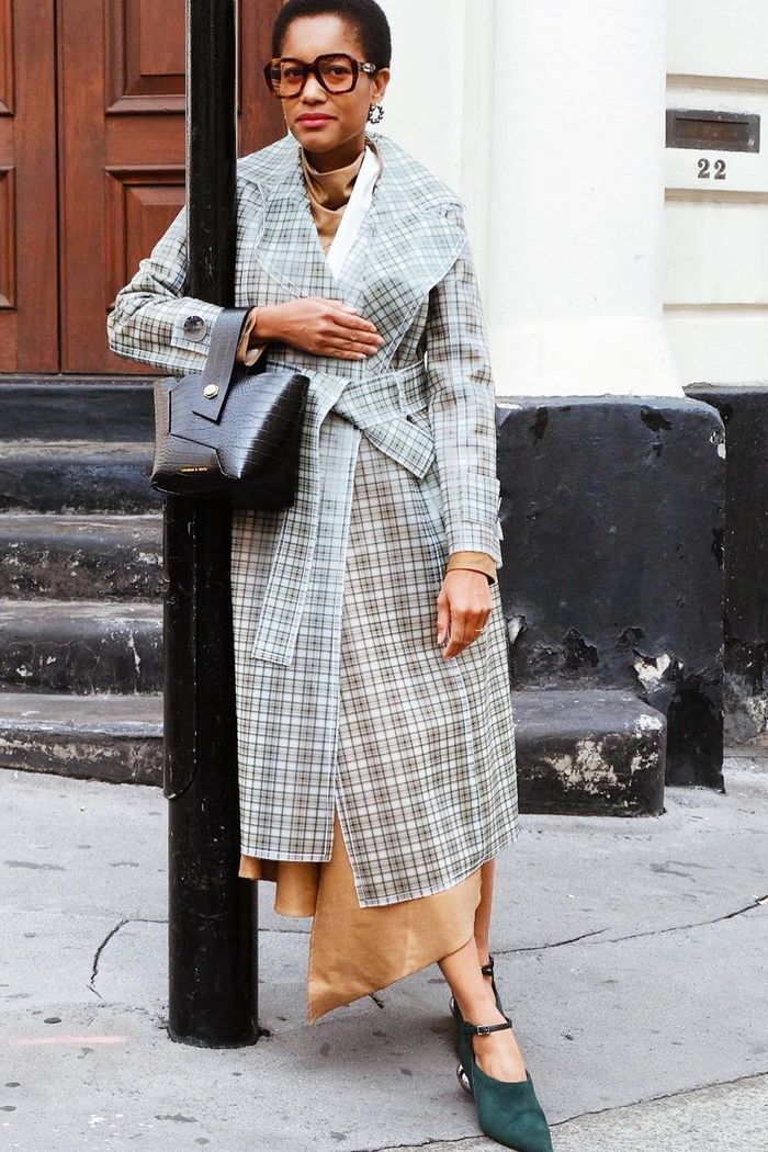 London Fashion Week street style 2018: Tamu McPherson wearing checked trench coat
