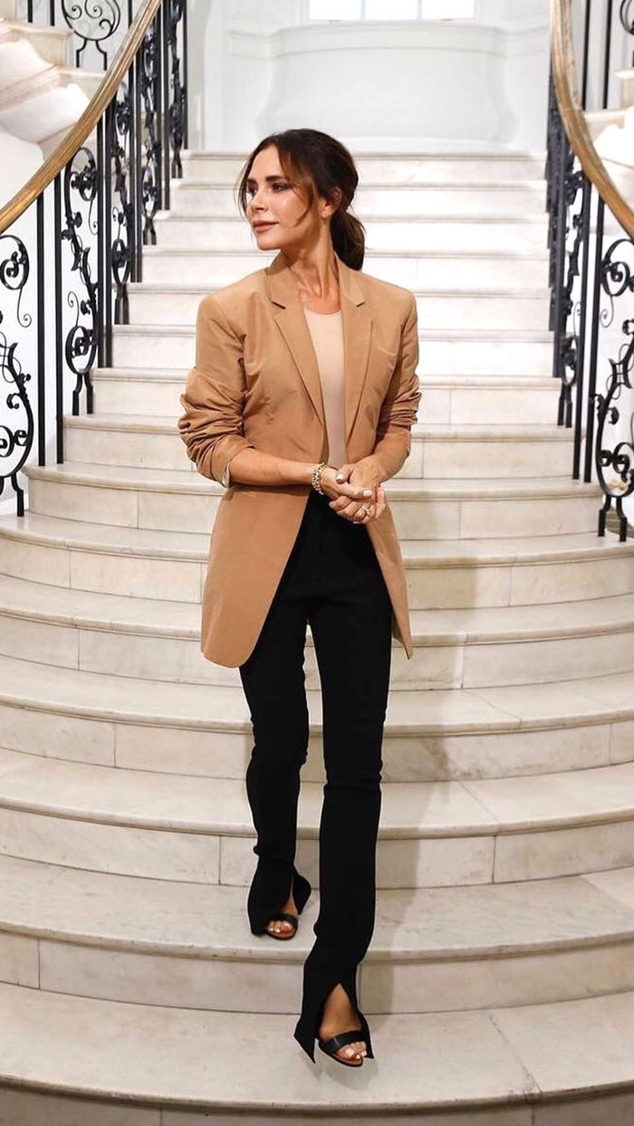 Victoria Beckham London Fashion Week Outfit: Camel blazer with black trousers and strappy heels