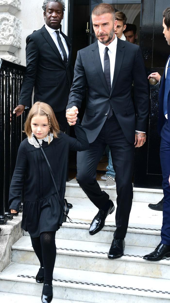 Harper Beckham at London Fashion Week with David Beckham
