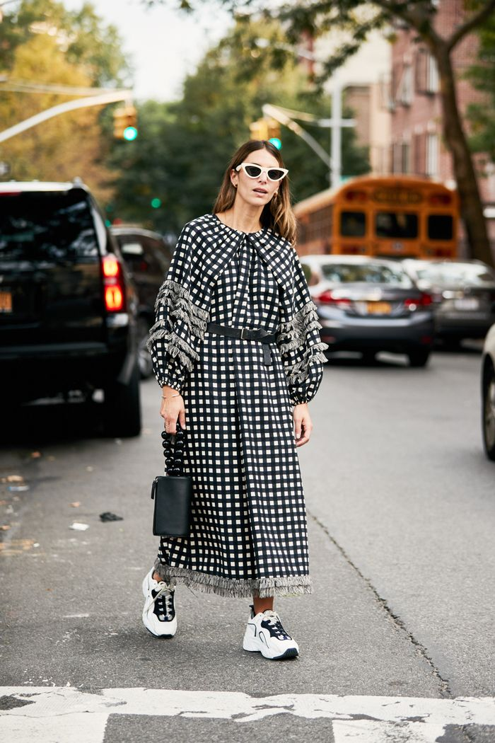 NYFW outfit trends: dress-with-sneakers outfit
