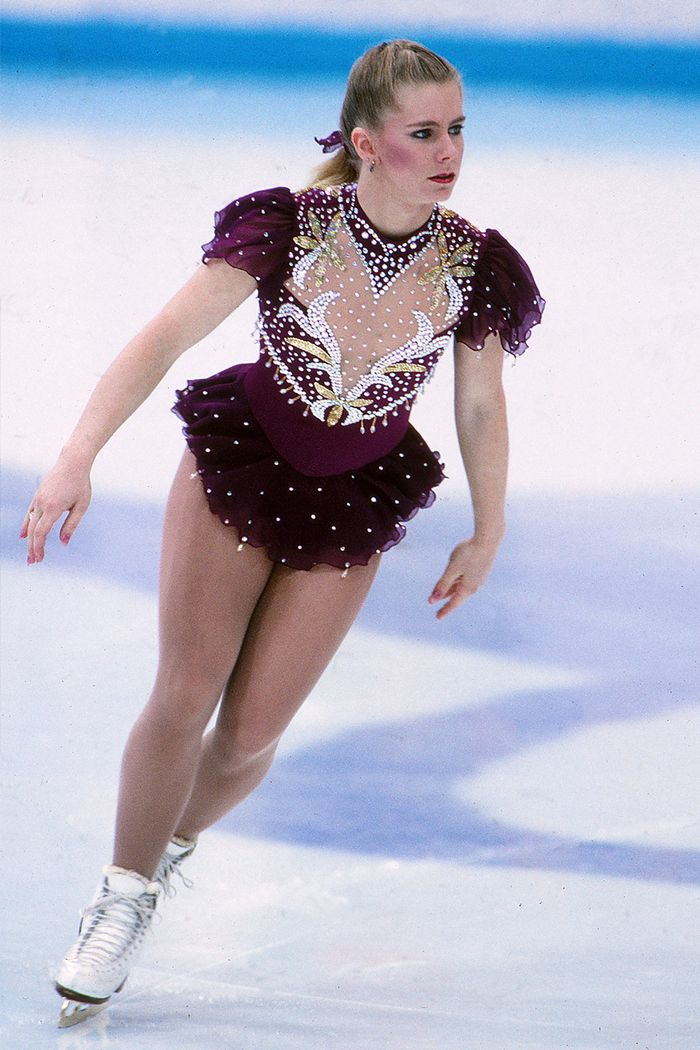 Halloween costume ideas: Tonya Harding wearing a purple ice skating costume
