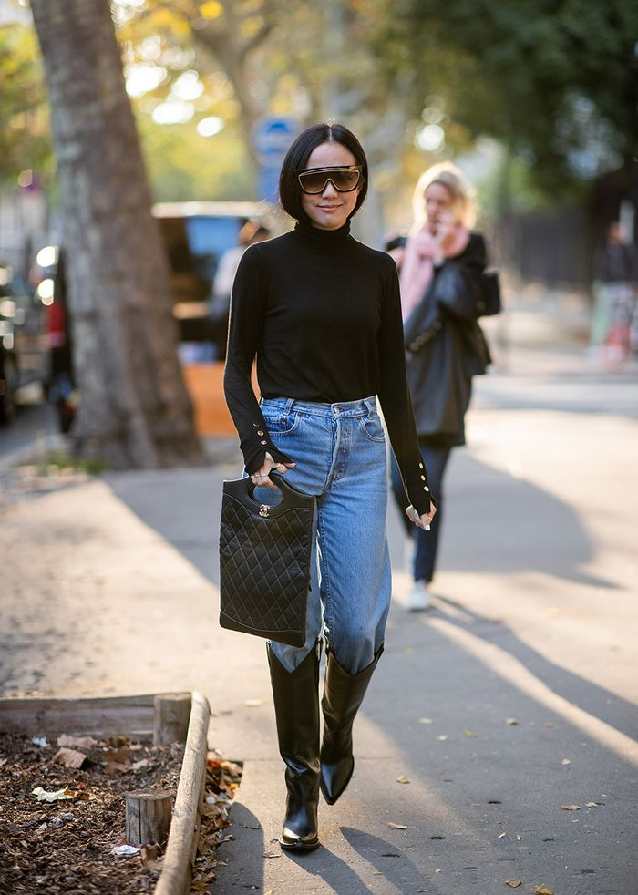 Black turtleneck with cowboy boots