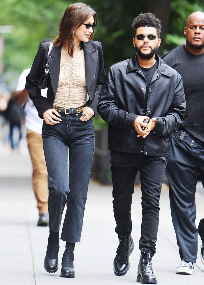Bella Hadid and The Weeknd in black boots