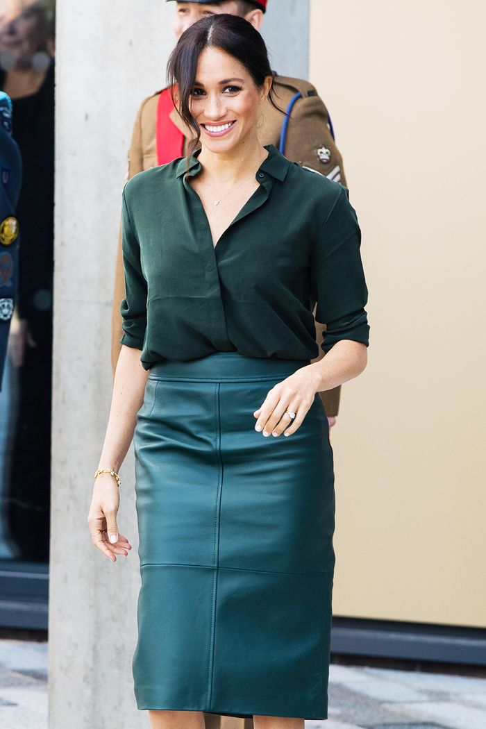 Meghan Markle Autralia wardrobe: Meghan wearing & Other Stories silk shirt and green leather skirt