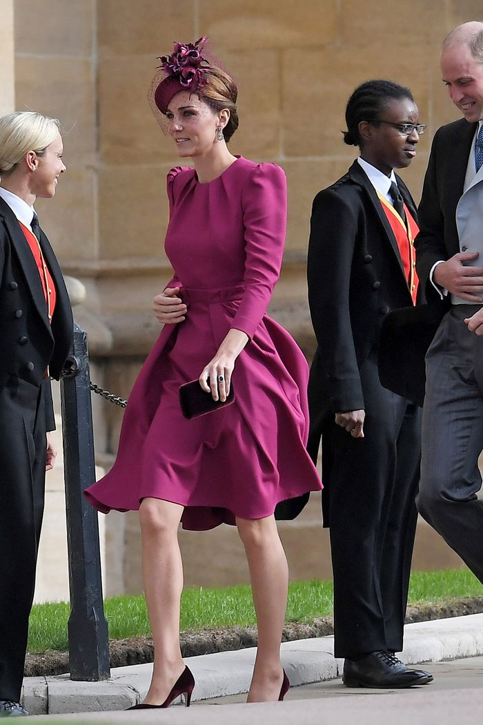 Kate Middleton wearing a raspberry pink Alexander McQueen dress for Princess Eugenie's wedding with Jimmy Choo velvet pumps