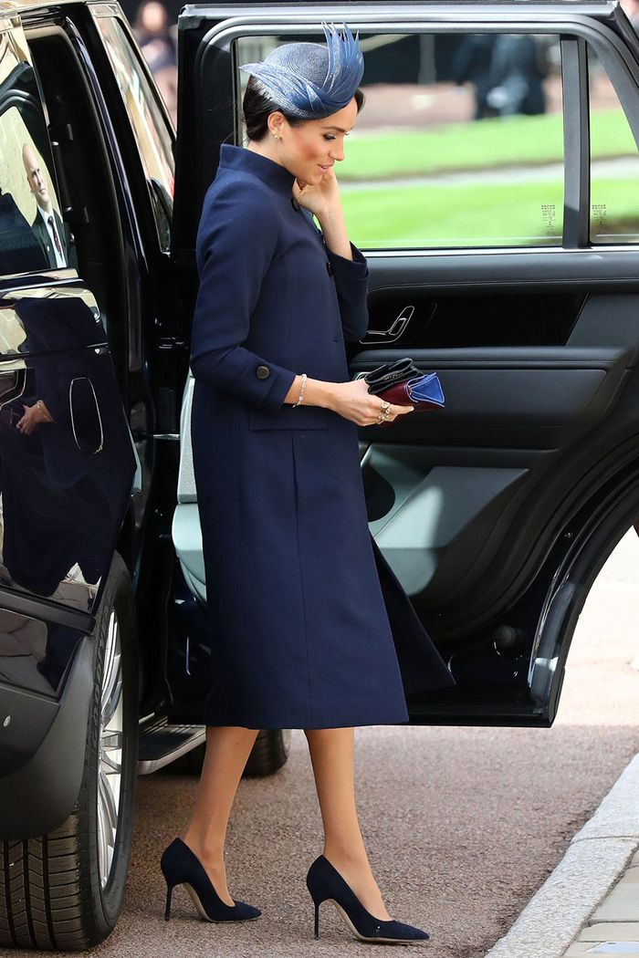 Meghan Markle wearing a navy coat and dress from Clare Waight Keller's Givenchy with navy Manolo Blahnik pumps