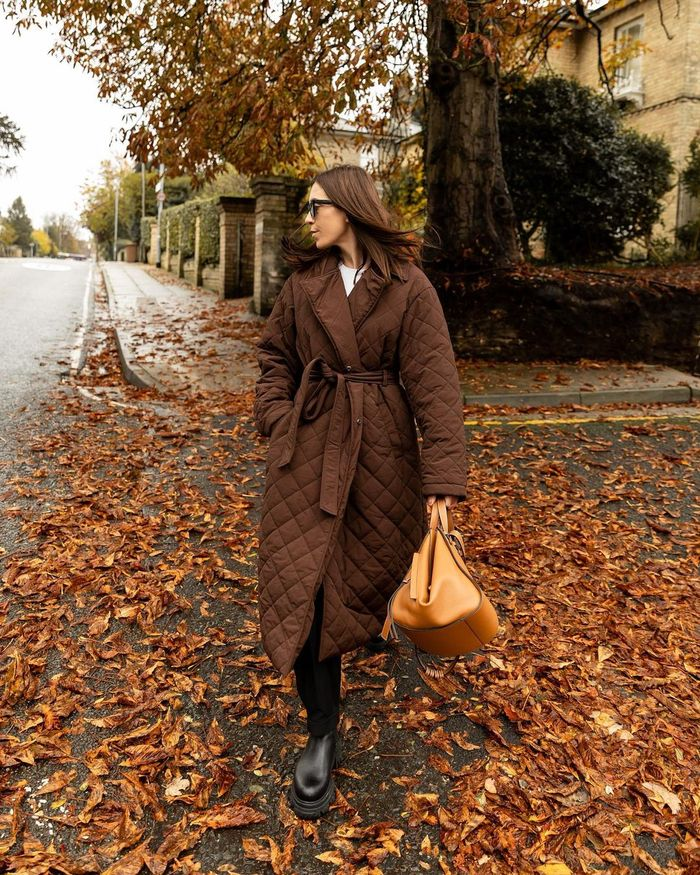 Best Cold Weather Clothing: @_jessicaskye wears a padded coat