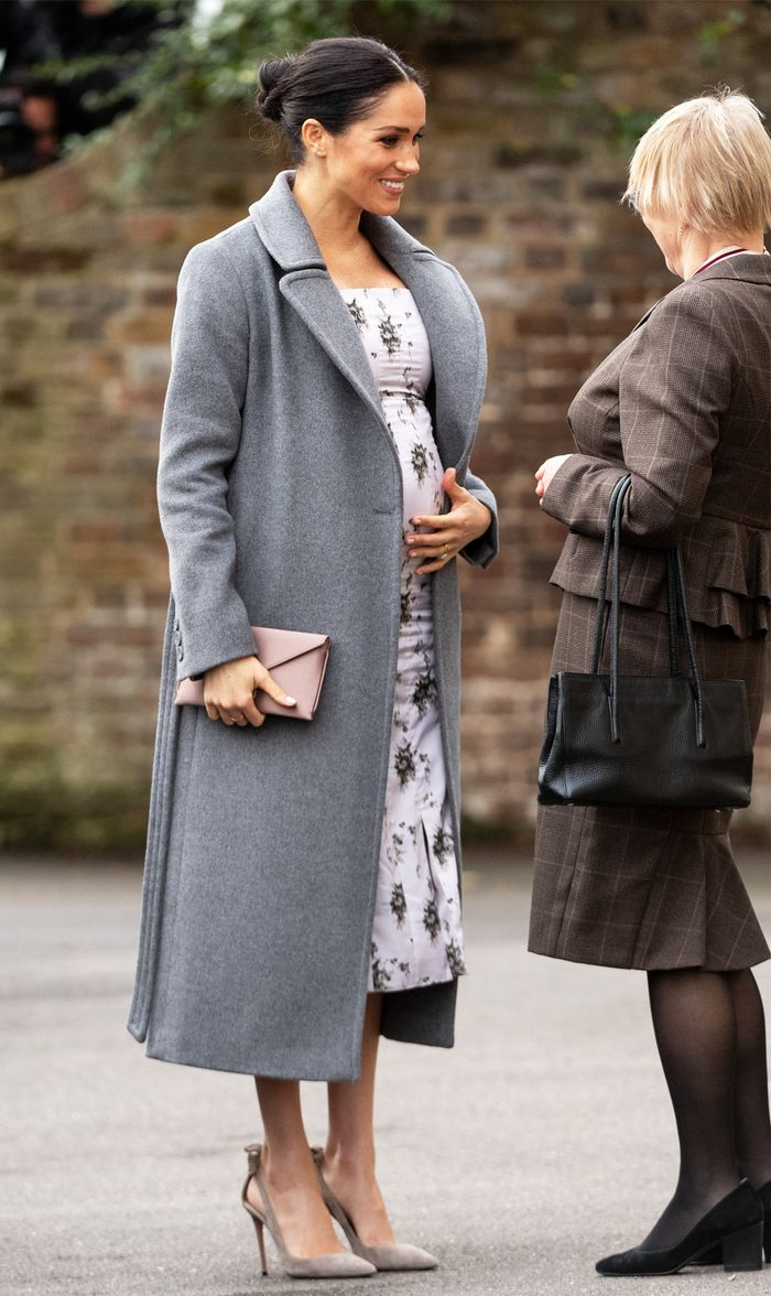 Meghan Markle Maternity Style: The Duchess of Sussex looked the epitome of chic as she visited the Royal Variety Charity's residential nursing and care home at Brinsworth House on December 18, 2018.
