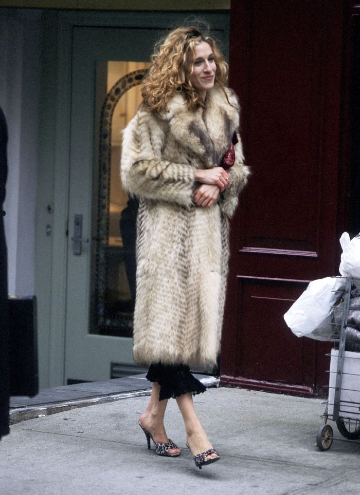 Carrie Bradshaw winter outfits: wearing a faux fur coat with mule sandals