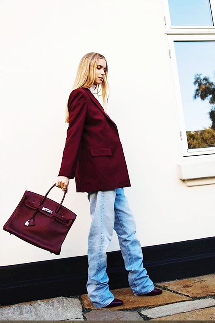 Winter Colours: Pernille wearing a wine-red blazer with baggy jeans and a matching Birkin  bag