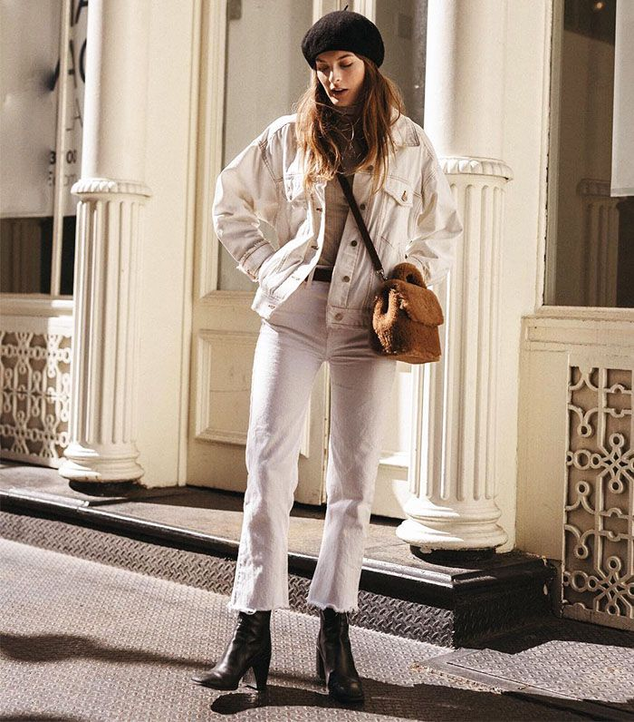 The 7 Best Roll Necks: Christie Tyler wearing a beige roll neck with a white denim jacket