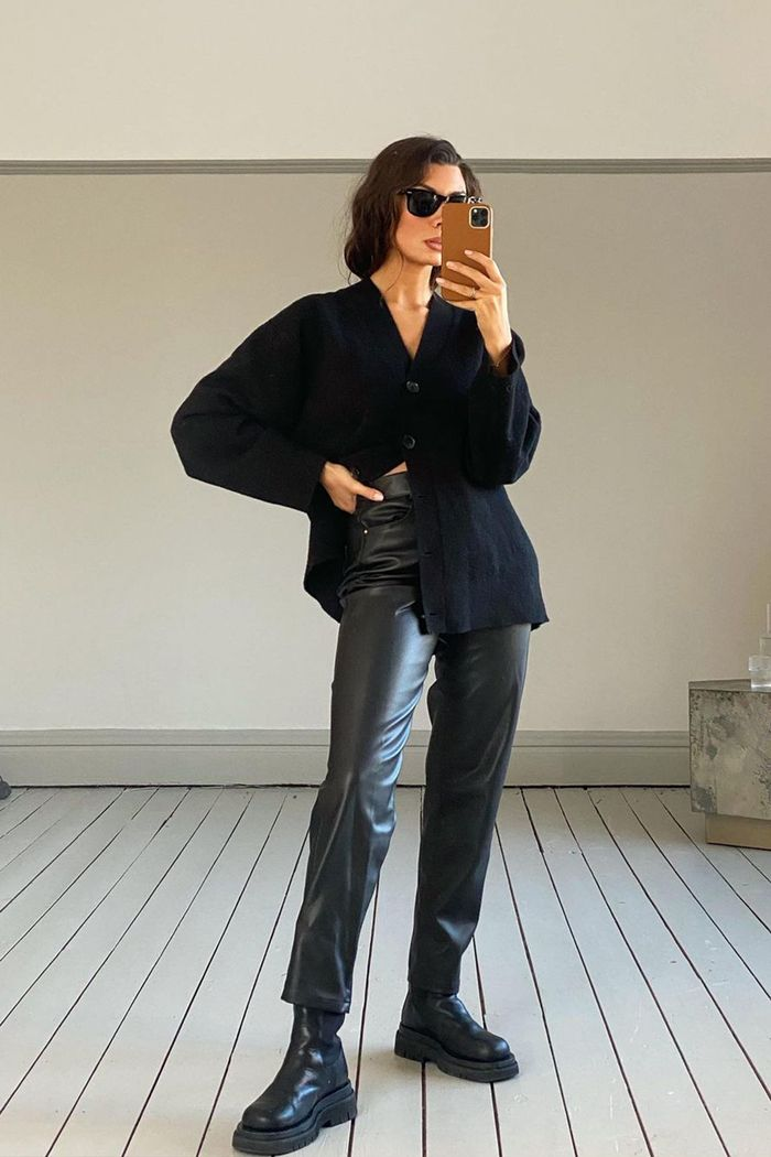 best leather trousers: black leather trousers with a cardigan and chunky boots
