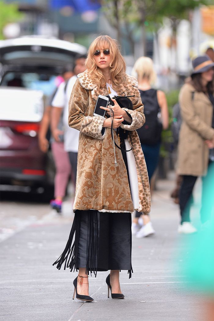 Celebrity winter outfits: Suki Waterhouse wearing a leopard and brocade coat with culottes