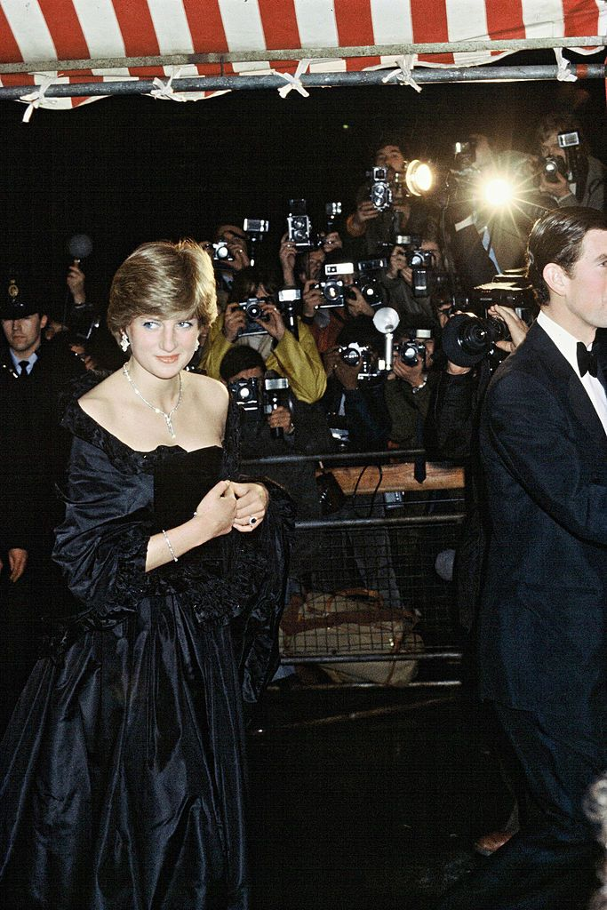 Princess Diana Party Outfits: Diana wears a black ballgown for her first official outing as Prince Charles's fiancée.
