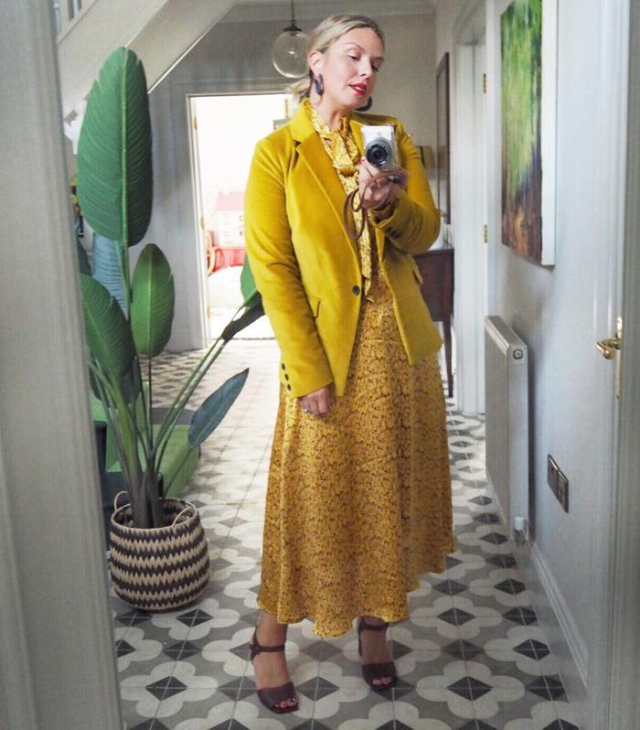 Supermarket fashion brands: Erica Davies wearing a yellow M&S dress