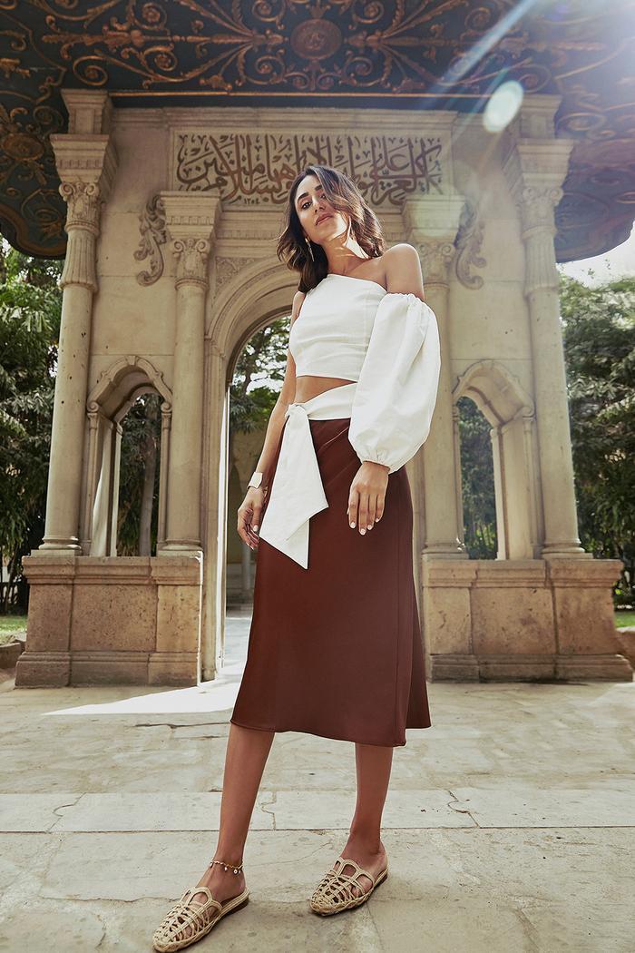Soraya Bakhtiar Maison Pyramide: Soraya Bakhtiar  wearing brown skirt and white top
