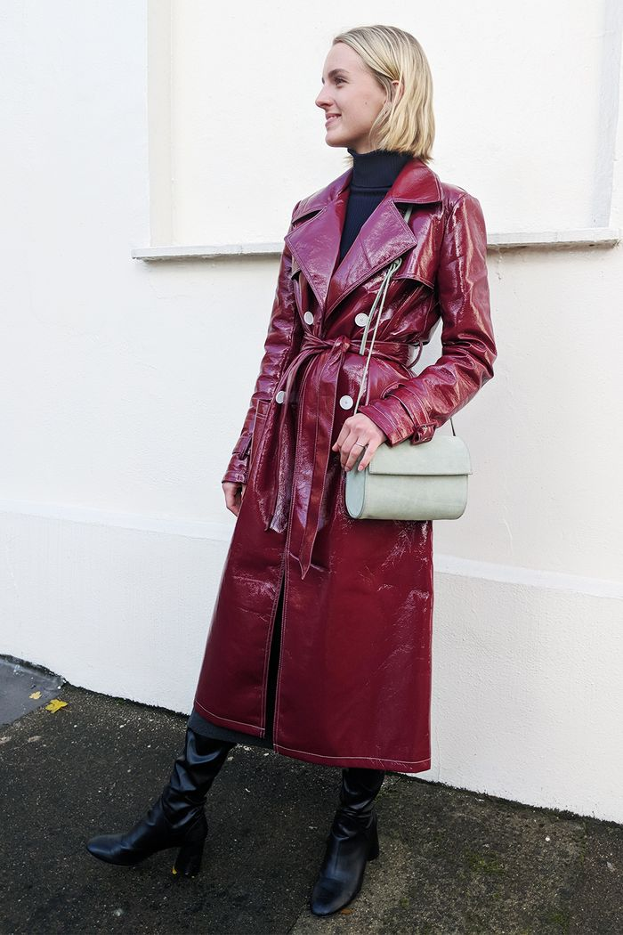 Shoes capsule wardrobe: Joy Montgomery wearing patent coat and knee-high boots