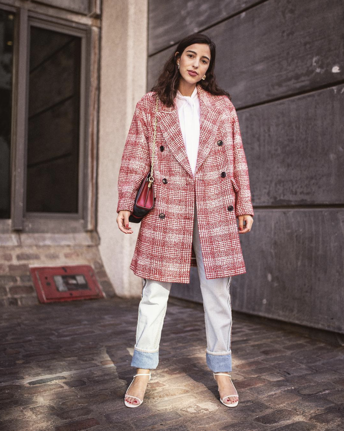 Light-wash jeans outfit with plaid coat