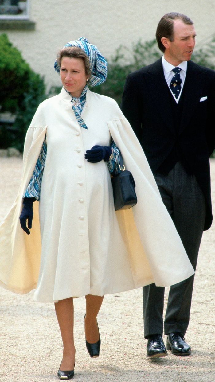 Princess Anne Royal Style: White maternity cape with black bag
