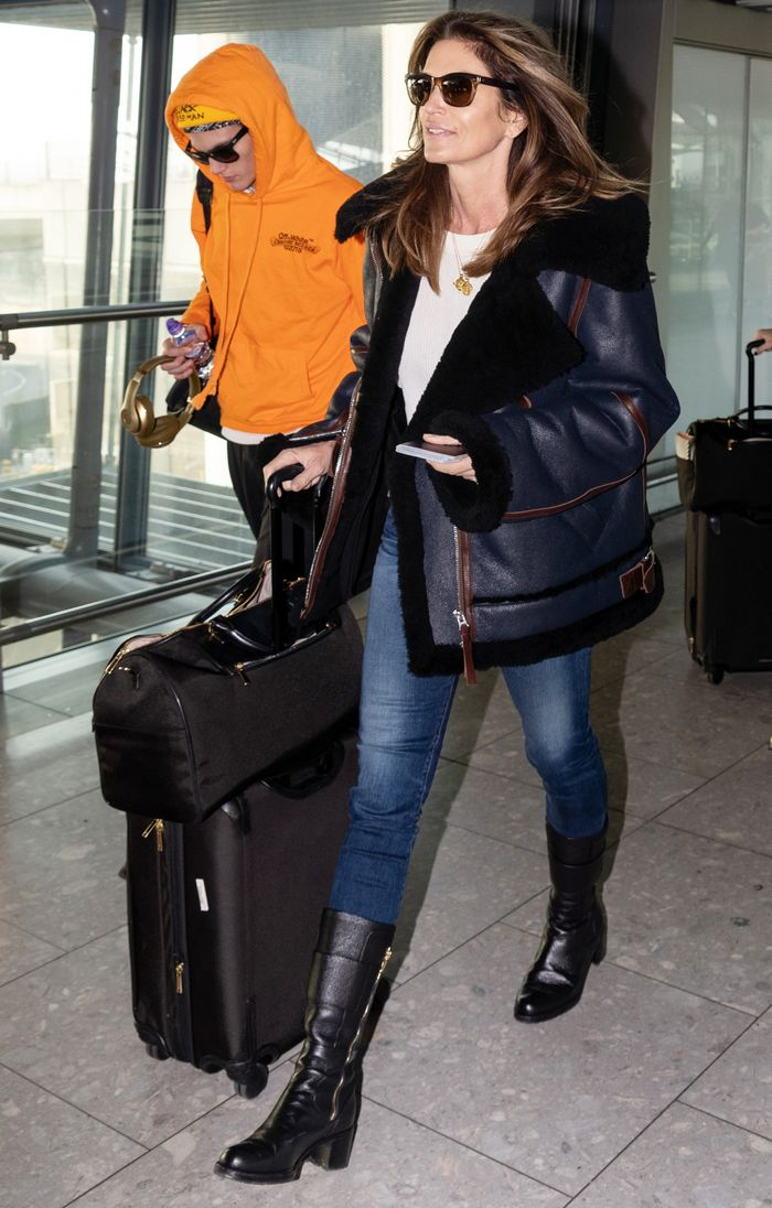 Cindy Crawford Skinny Jeans and Boots Outfit