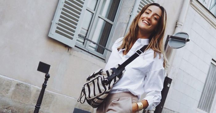 Laughing Woman in France Every time Americans Wear These 3 Things