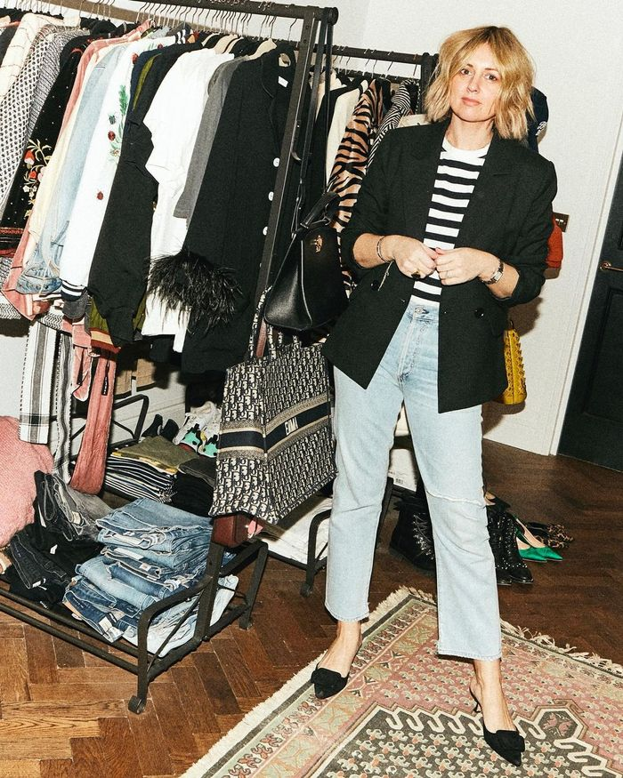 How to Repeat Outfits: Emma wears the classic outfit combination of blue jeans and Breton stripes