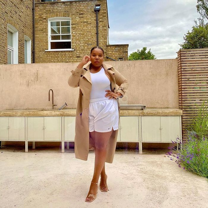 How to Repeat Outfits: Chloé Pierre wears a trench coat with a racer vest in different seasons
