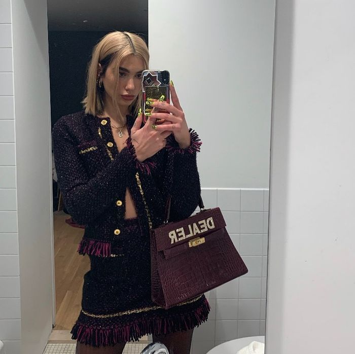 Dua Lipa Style: Dua Lipa wears a tweed two piece