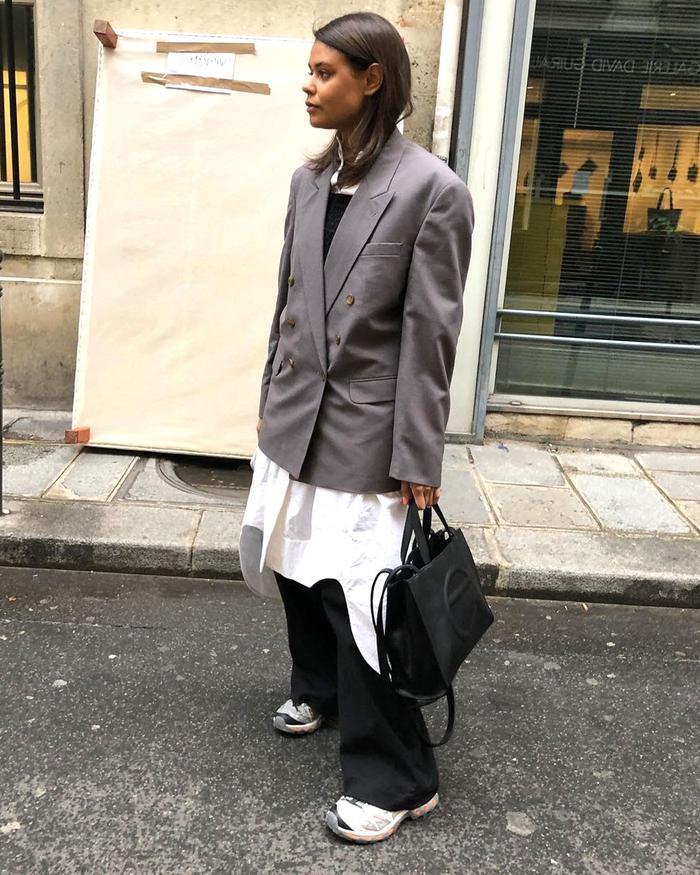 Best Minimalist Shopping: Stylist Maya Soul Paustian wears oversized COS shirt with Blazer
