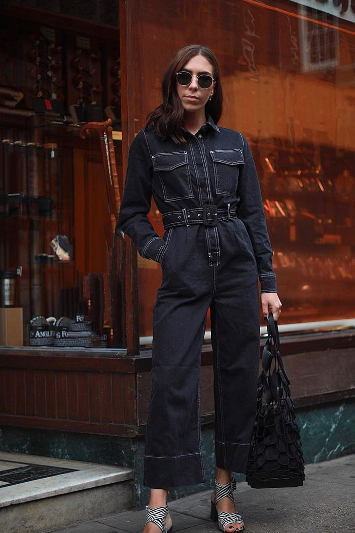 Topshop boilersuit: Jessica Skye wearing a dark denim jumpsuit with a belted waist