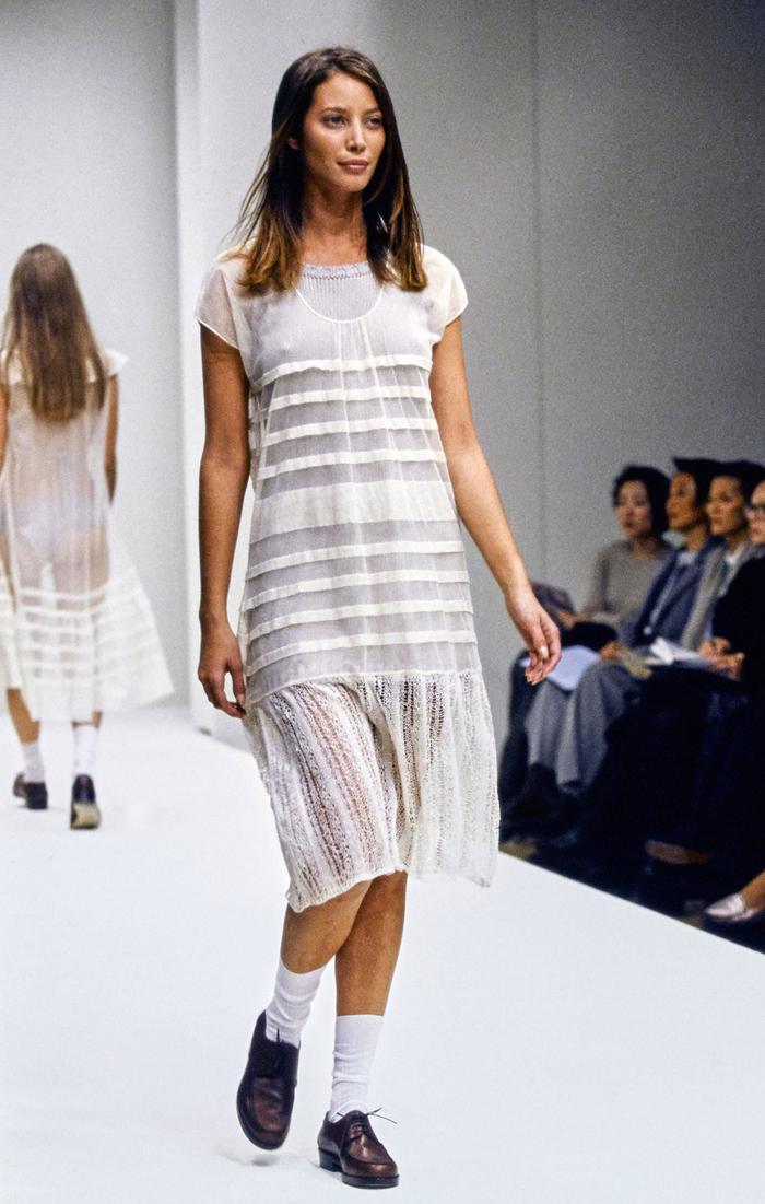 White socks and flat shoes: Christy Turlington models for Prada 1994