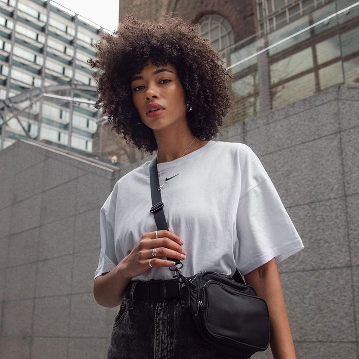 Best Affordable Beauty Buys: ASOS Lesley wearing white tee and crossbody bag