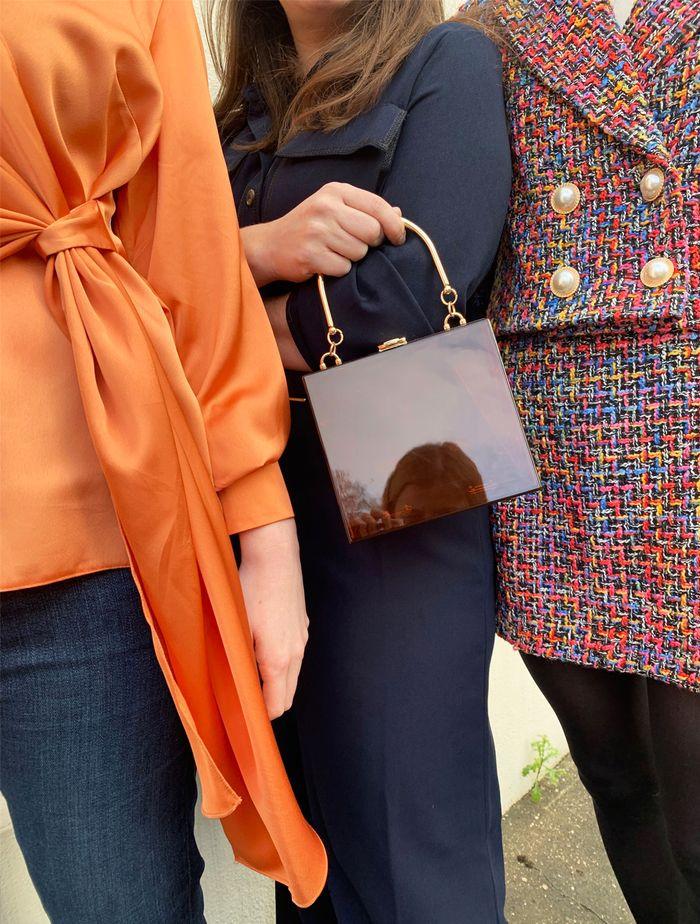 ASOS spring outfits: orange satin blouse and tweed colourful suit close up